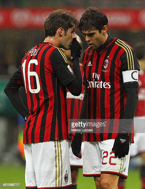 Andrea Poli of AC Milan speaks to Ricardo Kaka during the Serie A match between AC Milan and Genoa CFC at Stadio Giuseppe Meazza on November 23 2013...
