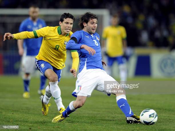Andrea Poli of Italy and Hernanes of Brazil compete for the ball during the international friendly match between Italy and Brazil on March 21 2013 in...