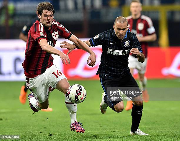 Andrea Poli of Milan and Rodrigo Palacio of Internazionale Milano in action during the Serie A match between FC Internazionale Milano and AC Milan at...
