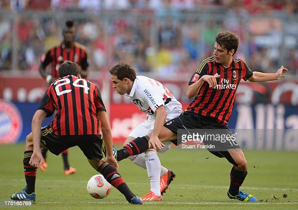 Andrea Poli of Milan challenges Silvinho of Sao Paulo during the third place match between FC Sao Paulo and AC Milan at Allianz Arena on August 1...