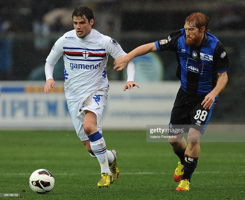<a gi-track='captionPersonalityLinkClicked' href=/galleries/search?phrase=Andrea+Poli&family=editorial&specificpeople=4520865 ng-click='$event.stopPropagation()'>Andrea Poli</a> of UC Sampdoria competes for the ball with Davide Biondini (R) of Atalanta BC during the Serie A match between Atalanta BC and UC Sampdoria at Stadio Atleti Azzurri d'Italia on March 30, 2013 in Bergamo, Italy.