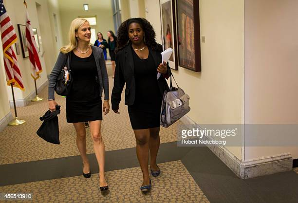 Andrea Powell left the director of FAIR Girls and Kiana McWeay right walk to a City Council meeting July 10 2014 in Washington DC FAIR Girls is an...