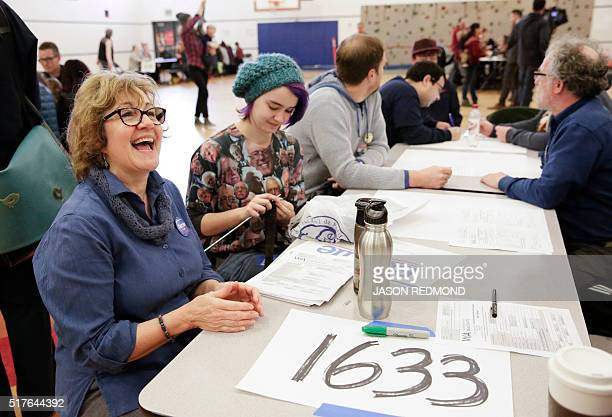 Andrea Ptak and her daughter Dakota Houseknecht talk to other voters during Washington State Democratic Caucuses at Martin Luther King Elementary...