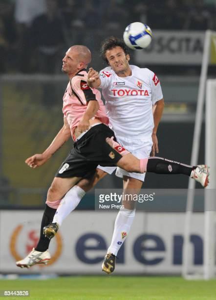 Andrea Raggi of Palermo and Alberto Gilardino of Fiorentina in action during the Serie A match between Palermo and Fiorentina at the Stadio Barbera...