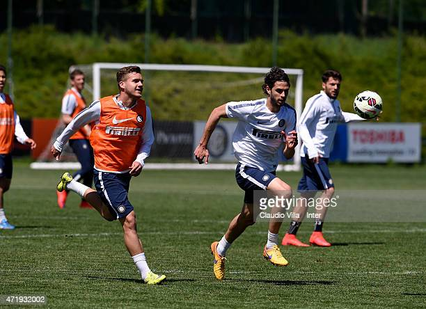 Andrea Ranocchia and George Puscas during FC Internazionale training session at the club's training ground at Appiano Gentile on May 02 2015 in Como...