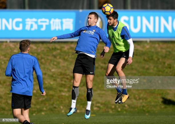 Andrea Ranocchia and Ivan Perisic of FC Internazionale compete for the ball during the FC Internazionale training session at Suning Training Center...