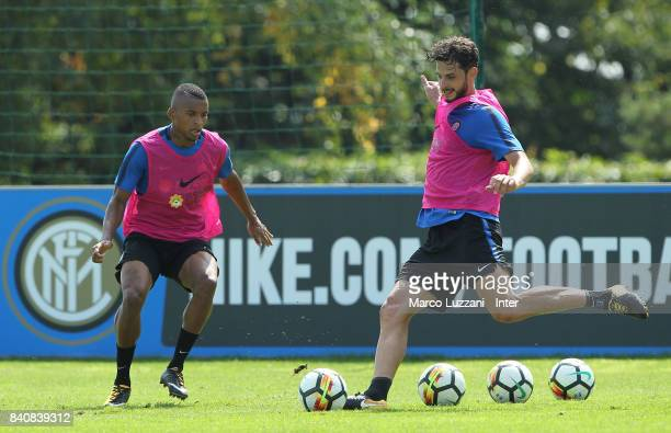 Andrea Ranocchia is challenged by Henrique Dalbert during the FC Internazionale training session at the club's training ground Suning Training Center...