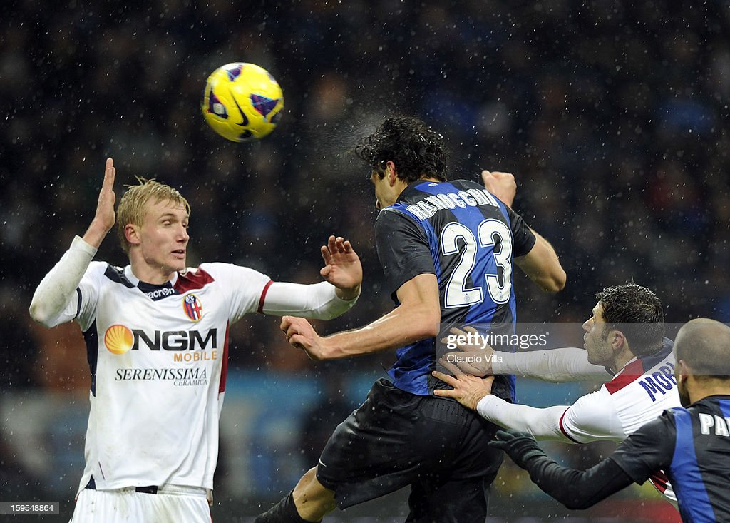 <a gi-track='captionPersonalityLinkClicked' href=/galleries/search?phrase=Andrea+Ranocchia&family=editorial&specificpeople=4085825 ng-click='$event.stopPropagation()'>Andrea Ranocchia</a> of FC Inter scores the third goal during the TIM cup match between FC Internazionale Milano and Bologna FC at Stadio Giuseppe Meazza on January 15, 2013 in Milan, Italy.