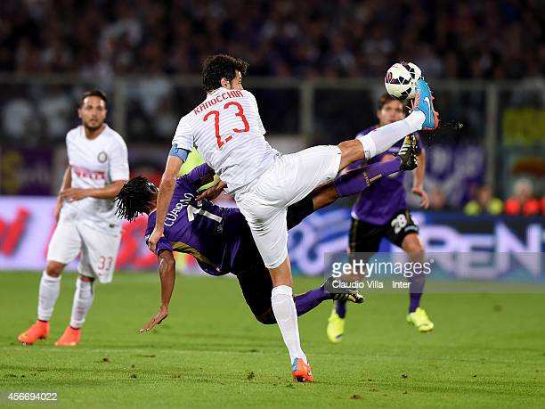 Andrea Ranocchia of FC Internazionale and Juan Guillermo Cuadrado of ACF Fiorentina compete for the ball during the Serie A match between ACF...