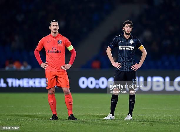 Andrea Ranocchia of FC Internazionale and Zlatan Ibrahimovic of Paris Saint Germain look on during the Qatar Winter Tour match betweeen Paris Saint...