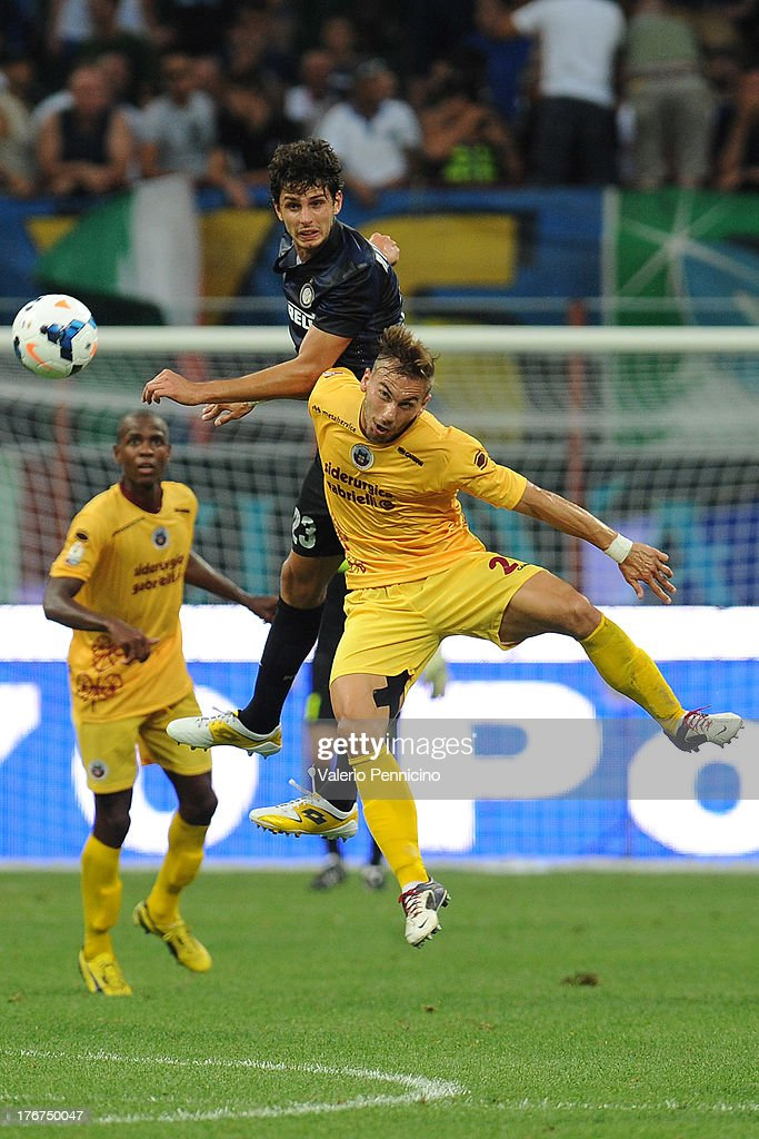 Andrea Ranocchia (L) of FC Internazionale Milano goes up with Leonardo Perez of AS Cittadella during the TIM cup match between FC Internazionale Milano and AS Cittadella at Stadio Giuseppe Meazza on August 18, 2013 in Milan, Italy.
