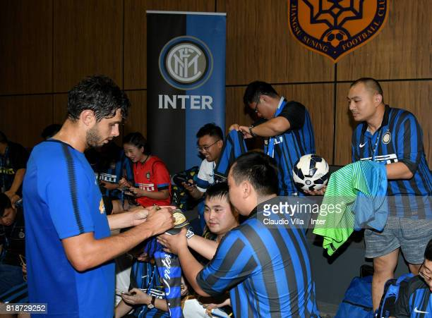 Andrea Ranocchia of FC Internazionale signs autographs for fans during a FC Interazionale training session at Suning training center on July 19 2017...