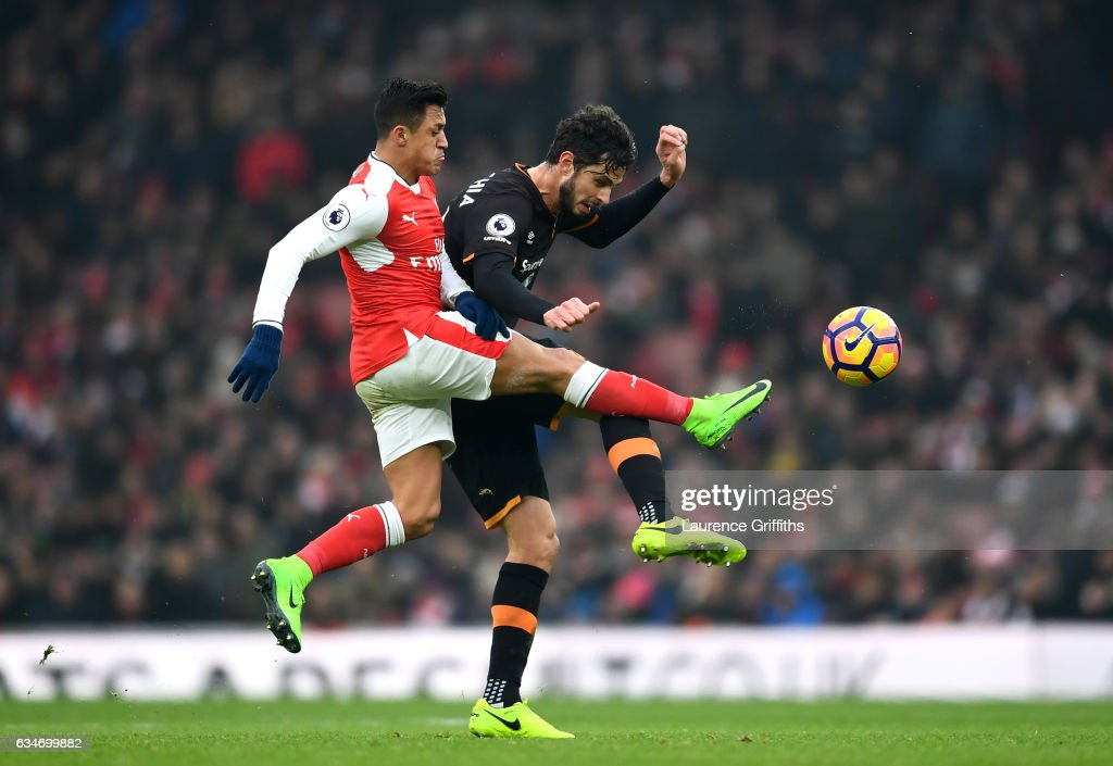 Andrea Ranocchia of Hull City and Alexis Sanchez of Arsenal compete for the ball during the Premier League match between Arsenal and Hull City at Emirates Stadium on February 11, 2017 in London, England.
