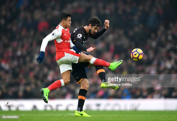 Andrea Ranocchia of Hull City and Alexis Sanchez of Arsenal compete for the ball during the Premier League match between Arsenal and Hull City at...
