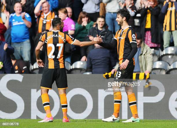 Andrea Ranocchia of Hull City celebrates scoring his sides second goal with Ahmed Elmohamady of Hull City during the Premier League match between...