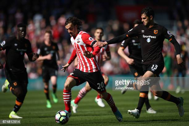 Andrea Ranocchia of Hull City pulls back Manolo Gabbiadini of Southampton during the Premier League match between Southampton and Hull City at St...