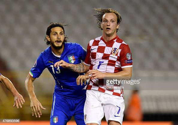 Andrea Ranocchia of Italy and Ivan Rakitic compete during the UEFA Euro 2016 Qualifier between Croatia and Italy on June 12 2015 in Split Croatia