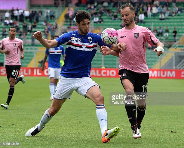 Andrea Ranocchia of Sampdoria and Alberto Gilardino of Palermo compete for the ball during the Serie A match between US Citta di Palermo and UC...