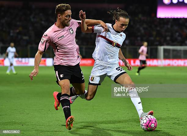 Andrea Rispoli of Palermo and Diego Laxalt of Genoa compete for the ball during the Serie A match between US Citta di Palermo and Genoa CFC at Stadio...