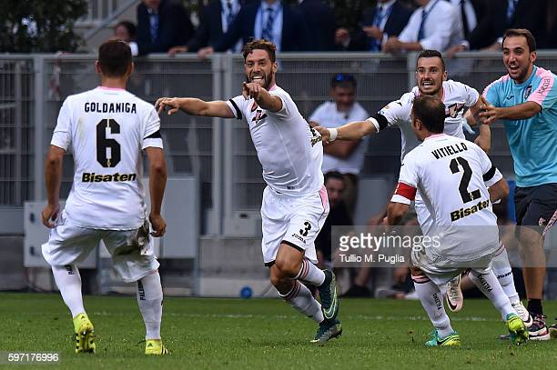 Andrea Rispoli of Palermo celebrates with team mates after scoring the opening goal during the Seria A match between FC Internazionale and US Citta...