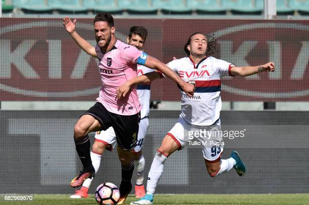 Andrea Rispoli of Palermo is challenged by Diego Laxalt of Genoa during the Serie A match between US Citta di Palermo and Genoa CFC at Stadio Renzo...
