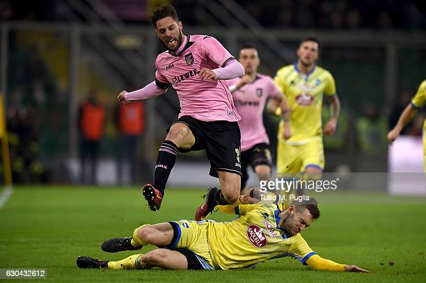Andrea Rispoli of Palermo jumps as Michele Fornasier of Pescara falls during the Serie A match between US Citta di Palermo and Pescara Calcio at...