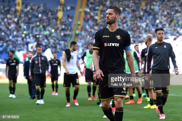 Andrea Rispoli of Palermo leaves the pitch after losing the Serie A match between SS Lazio and US Citta di Palermo at Stadio Olimpico on April 23...