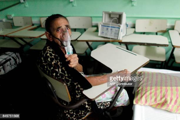 Andrea Rivera takes a respiratory therapy for emphysema at a shelter as Hurricane Maria approaches Puerto Rico in Fajardo on September 19 2017 Maria...