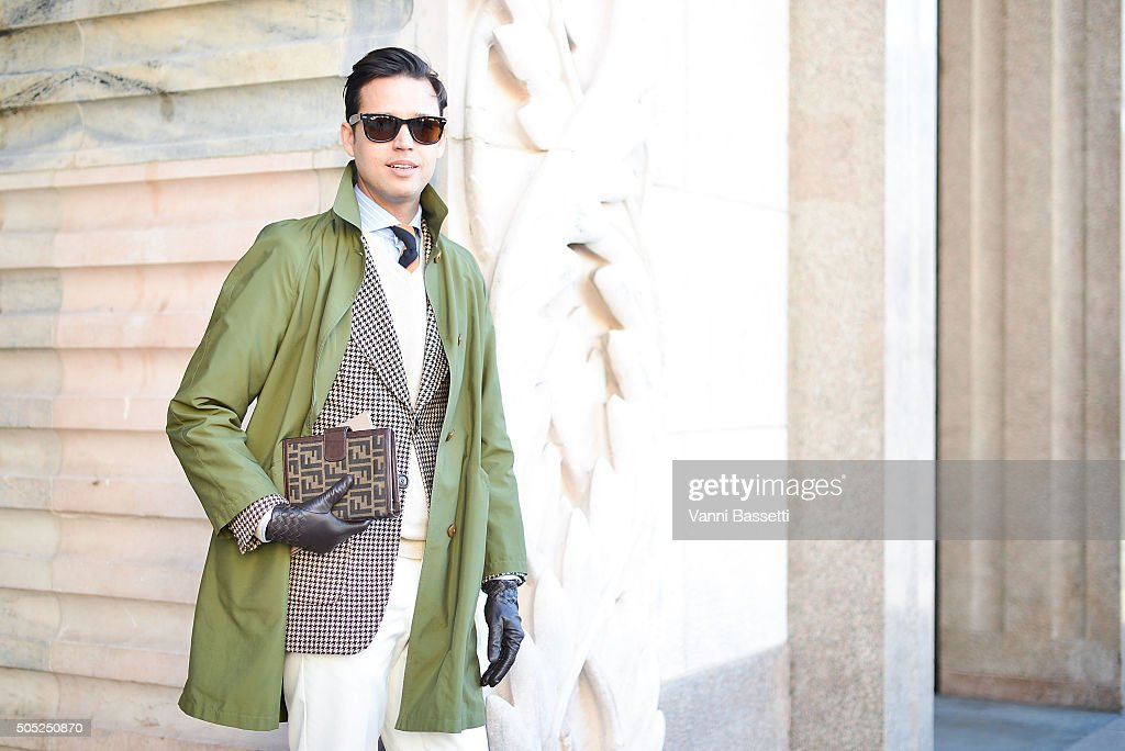 Andrea Romo poses in a vintage outfit before the Costume National show at Piazza del Duomo during the Milan Men's Fashion Week Fall/Winter 2016/17 on January 16, 2016 in Milan, Italy.