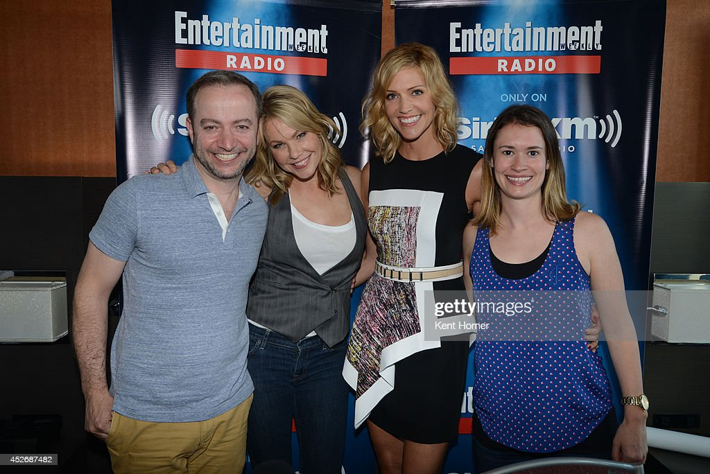 Andrea Roth and Tricia Helfer pose with radio hosts Mario Correa and Julia Cunningham after being interviewed on SiriusXM's Entertainment Weekly Radio channel from Comic-Con 2014 at The Hard Rock Hotel on July 25, 2014 in San Diego, California.