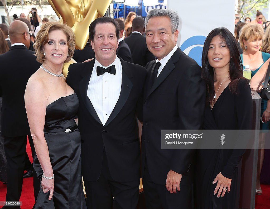 <a gi-track='captionPersonalityLinkClicked' href=/galleries/search?phrase=Andrea+Roth&family=editorial&specificpeople=617201 ng-click='$event.stopPropagation()'>Andrea Roth</a>, Warner Bros. Television Group president & Chief Content Officer <a gi-track='captionPersonalityLinkClicked' href=/galleries/search?phrase=Peter+Roth&family=editorial&specificpeople=239477 ng-click='$event.stopPropagation()'>Peter Roth</a>, Warner Bros. CEO Kevin Tsujihara and wife Sandy Tsujihara attend the 65th Annual Primetime Emmy Awards at the Nokia Theatre L.A. Live on September 22, 2013 in Los Angeles, California.