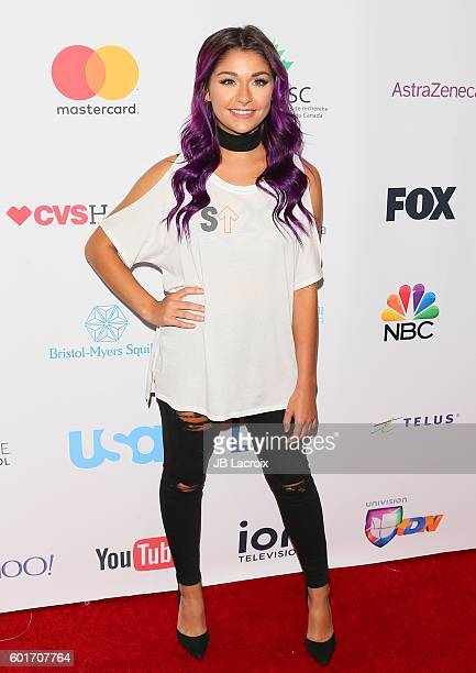 Andrea Russett attends Hollywood Unites for the 5th Biennial Stand Up To Cancer A Program of The Entertainment Industry Foundation at Walt Disney...
