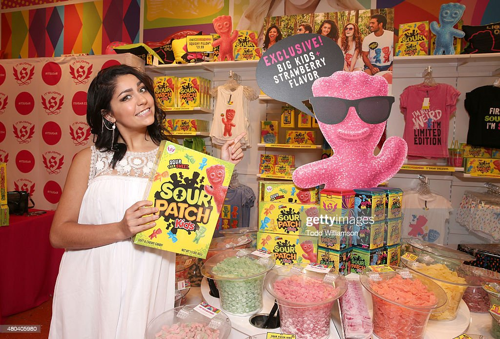 andrea russett helps launch exclusive sour patch kids collection at fashion island at