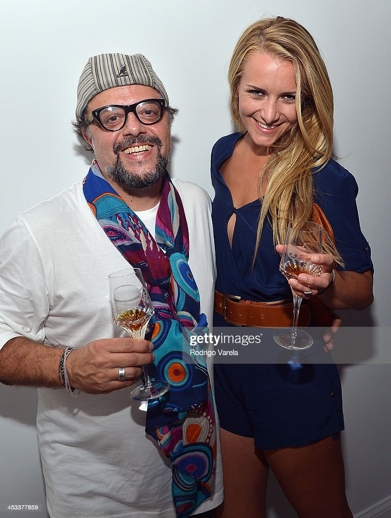Andrea Sampaolo and Kristina Sorge attend the Roman Kriheli Un:veiled Exhibit At Avant Gallery, Featuring The Unveiling Of 'The Most Beautiful Woman In The World' Painting at Epic Hotel on December 3, 2013 in Miami, Florida.