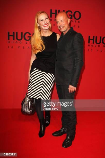 Andrea Sawatzki and Christian Berkel attend Hugo By Hugo Boss Autumn/Winter 2013/14 fashion show during MercedesBenz Fashion Week Berlin at The...