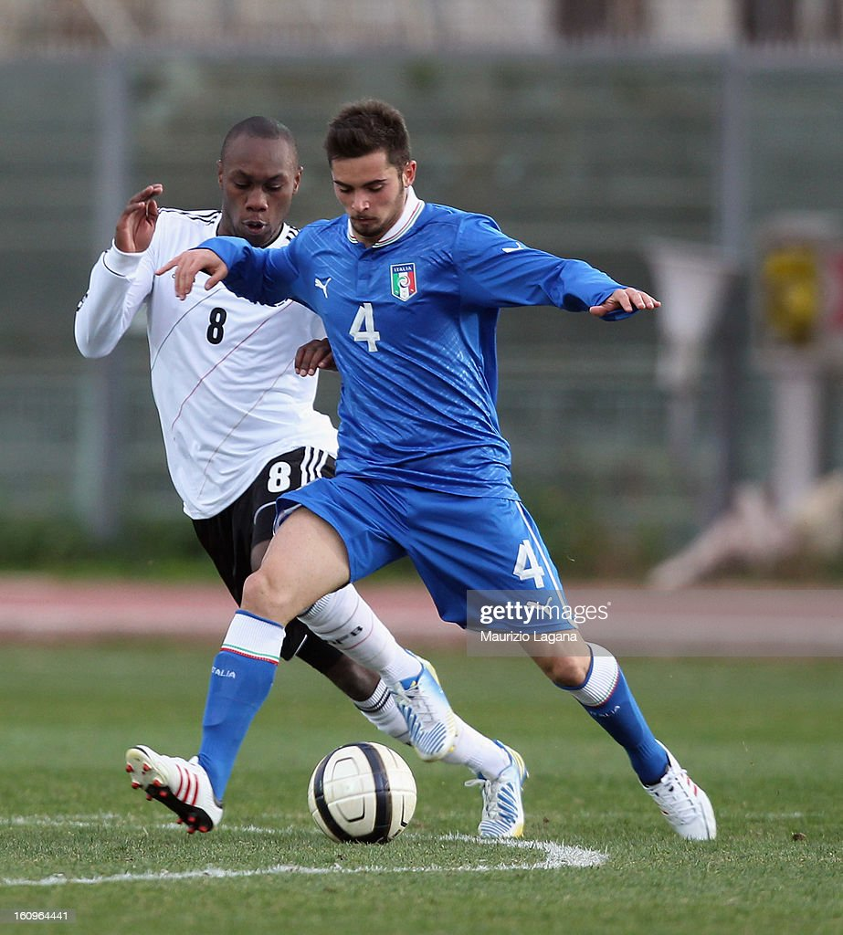 Andrea Schiavone (R) of Italy competes for the ball with Reinhold Yabo of Germany during U20 International Friendly match between Italy and Germany at Stadio Cosimo Puttilli on February 6, 2013 in Barletta, Italy.