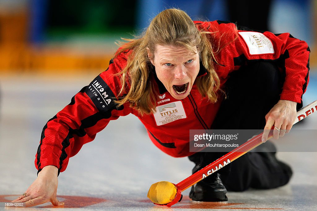 Andrea Schopp of Germany screams to her team mates after she releases the stone in the match between Japan and Germany during Day 3 of the Titlis Glacier Mountain World Women's Curling Championship at the Volvo Sports Centre on March 18, 2013 in Riga, Latvia.
