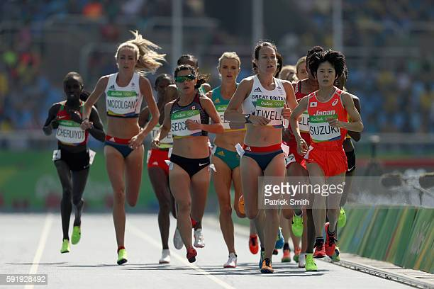 Andrea Seccafien of Canada Stephanie Twell of Great Britain and Ayuko Suzuki of Japan compete among others during the Women's 5000m Round 1 on Day 11...