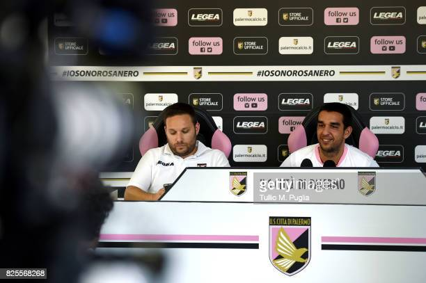 Andrea Siracusa Head of Press Office looks on as Giuseppe Bellusci answers questions during his presentation as new player of US Citta' di Palermo at...