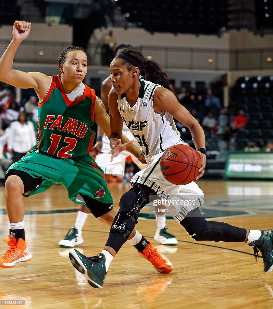Andrea Smith #21 of the South Florida Bulls drives as Kimberly Sparkman #12 of the Florida A&M Rattlers defends during the game at the Sun Dome on December 29, 2012 in Tampa, Florida.
