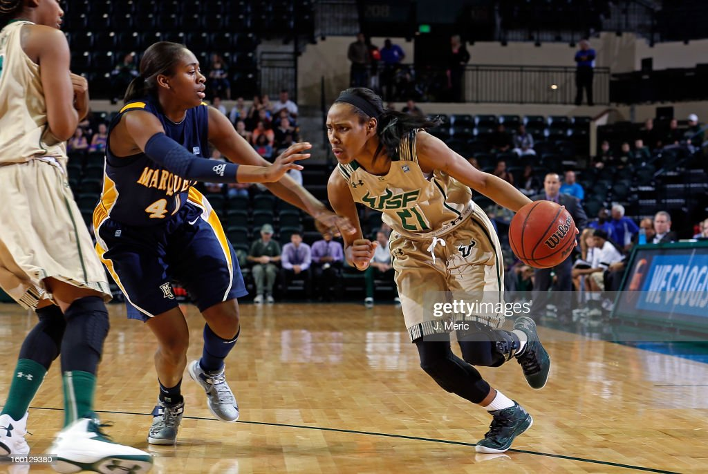 Andrea Smith #21 of the South Florida Bulls drives as Sarina Simmons #42 of the Marquette Golden Eagles defends during the game at the Sun Dome on January 26, 2013 in Tampa, Florida.