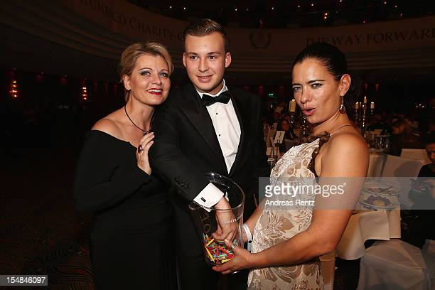 Andrea Spatzek with son Alexander and Sandra Speichert attend the 21st UNESCO Charity Gala 2012 on October 27 2012 in Dusseldorf Germany