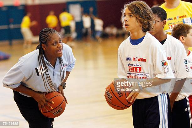 Andrea Stinson WNBA legend works with campers on basketball drills during the unveiling of the New Orleans AllStar logo at the Jr NBA/Jr WNBA...
