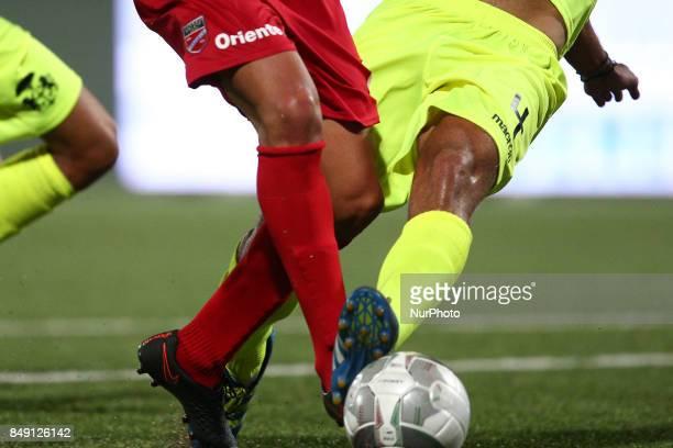 Andrea Venturini of FC Ravenna Calcio fouls Ciro Foggia of Teramo Calcio 1913 leading to a penalty during the Lega Pro 17/18 group B match between...