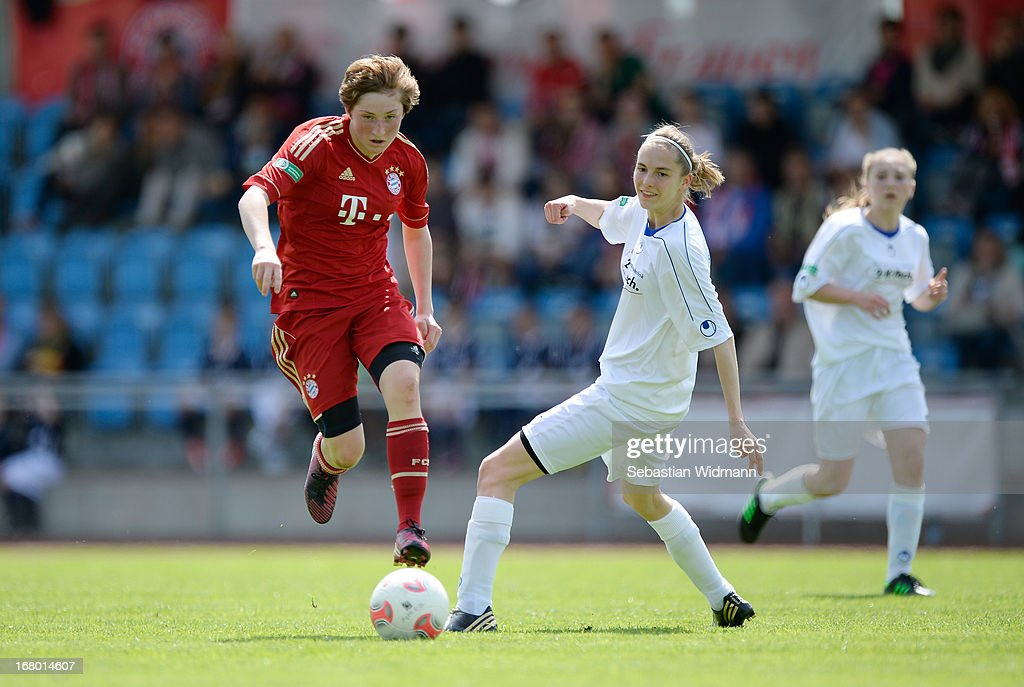Andrea Viehl of Muenchen challenges Bianca Bloechl of Sindelfingen during the B Junior Girls match between Bayern Muenchen and VfL Sindelfingen at Sportpark Aschheim on May 4, 2013 in Aschheim, Germany.