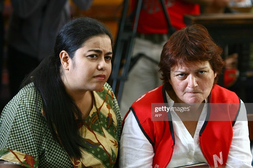 Andrea Waldeck (R) listens to a judge next to her interpreter (L) during trial at a court in Surabaya on January 22, 2014. A British woman was jailed for 14 years on January 22 but escaped the death penalty after admitting that she smuggled crystal methamphetamine into Indonesia from China.
