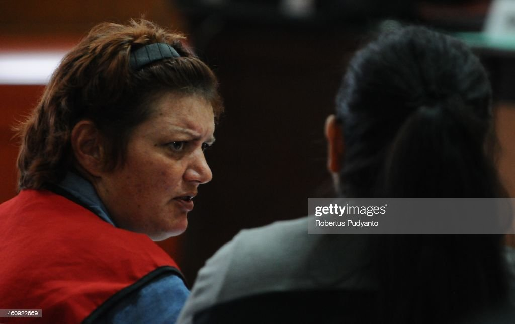 Andrea Waldeck of Britain (43) (L) attends in court at a hearing for drug trafficking charges on January 6, 2014 in Surabaya, Indonesia. Prosecutors are seeking a 16-year prison term and a fine of around £100,000 for Andrea Waldeck, who has admitted trafficking crystal meth into the country from China and previously faced the possibility of a death sentence. The former PCSO with Gloucestershire Police had pleaded guilty to the offence after being arrested in April in possession of 3lb of methamphetamine crystals hidden in her underwear.