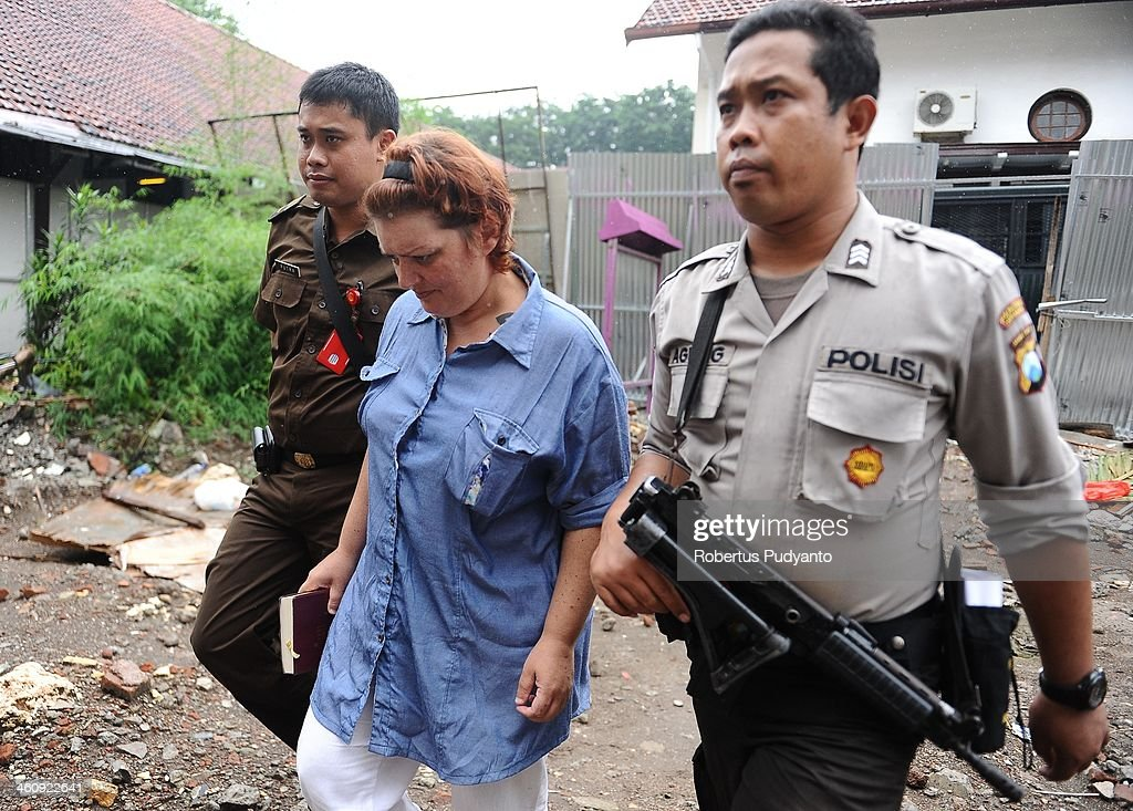 Andrea Waldeck of Britain (43) is escorted by Indonesian Policemen to a hearing for drug trafficking charges on January 6, 2014 in Surabaya, Indonesia. Prosecutors are seeking a 16-year prison term and a fine of around £100,000 for Andrea Waldeck, who has admitted trafficking crystal meth into the country from China and previously faced the possibility of a death sentence. The former PCSO with Gloucestershire Police had pleaded guilty to the offence after being arrested in April in possession of 3lb of methamphetamine crystals hidden in her underwear.