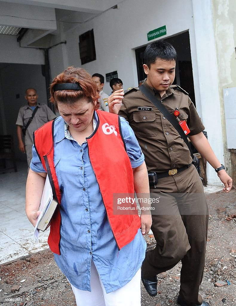 Andrea Waldeck of Britain (43) is escorted to a hearing for drug trafficking charges on January 6, 2014 in Surabaya, Indonesia. Prosecutors are seeking a 16-year prison term and a fine of around £100,000 for Andrea Waldeck, who has admitted trafficking crystal meth into the country from China and previously faced the possibility of a death sentence. The former PCSO with Gloucestershire Police had pleaded guilty to the offence after being arrested in April in possession of 3lb of methamphetamine crystals hidden in her underwear.