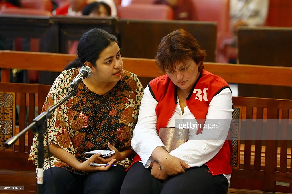 Andrea Waldeck of Britain (R) listens to a judge through her translater (L) during a trial in Surabaya on January 15, 2014. Andrea Waldeck was arrested in late April at a hotel in the city of Surabaya, East Java province with about 1.5 kilograms (three pounds) of crystal methamphetamine.